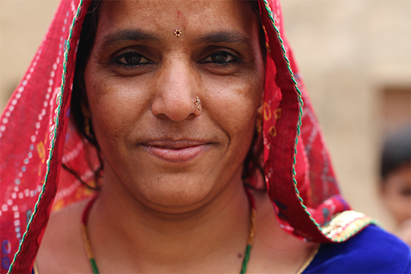 An Indian woman looks at the camera.