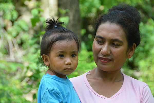 An Indonesian woman holds her child.