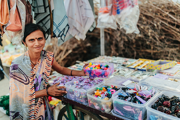 Ujjawala stands in front of her jewellery and accessories market stall